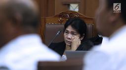 Hakim ad hoc nonaktif Pengadilan Tipikor Medan, Merry Purba saat menjalani sidang lanjutan di Pengadilan Tipikor, Jakarta, Kamis (21/2). Sidang mendengar keterangan tiga orang saksi yang diajukan JPU KPK. (Liputan6.com/Helmi Fithriansyah)