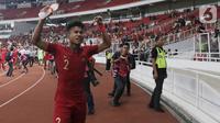 Bek Timnas Indonesia, Amiruddin Bagas Arrizqi merayakan hasil imbang melawan Korea Utara pada laga kualifikasi Grup K Piala AFC U-19 2020 di Stadion Utama Gelora Bung Karno, Jakarta, Minggu (10/11/2019). Indonesia lolos ke putaran Piala AFC U-19 2020. (Liputan6.com/Helmi Fithriansyah)