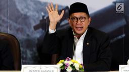 Menteri Agama Lukman Hakim memberikan keterangan hasil sidang isbat di Jakarta,  Kamis (14/6). Pemerintah melalui mekanisme sidang isbat menetapkan 1 Syawal 1439 Hijriah jatuh pada Jumat 15 Juni 2018 (Liputan6.com/Johan Tallo)