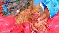 Ilustrasi - Pasangan pengantin. (Foto: Liputan6.com/Muhamad Ridlo)