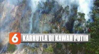 Kebakaran diduga dipicu ulah warga yang membuang puntung rokok sembarang diantara ranting-ranting pohon yang mengering akibat musim kemarau.
