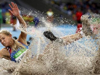 Darya Igorevna Klishina adalah atlet lompat jauh Rusia. Sebagai juara Universiade 2013, Darya Klishina bisa tampil di Olimpiade Rio 2016, namun hanya berada di peringkat ke-9. (Reuters/Phil Noble)