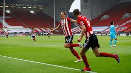 Gelandang Sheffield United, Sander Berge berselebrasi dusai mencetak gol ke gawang Tottenham Hotspur pada pertandingan lanjutan Liga Inggris di Bramall Lane di Sheffield, Inggris (2/7/2020). Sheffield United menang telak 3-1 atas Tottenham. (Oli Scarff/Pool via AP)