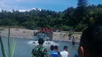 Aksi tank mengangkut anak-anak PAUD sudah rutin dilakukan di Purworejo sebagai upaya mendekatkan diri antara TNI dan anak-anak. (dok. BNPB/Edhie Prayitno Ige)