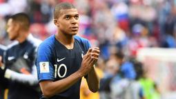 1. Kylian Mbappe (Prancis) - Pesepak bola muda termahal di dunia ini sukses menjuarai Liga 1 Prancis bersama PSG. Penampilan apik pemain berusia 19 tahun itu diharapkan mampu membawa Timnas Prancis menjuarai Piala Dunia 2018. (AFP/Franck Fife)