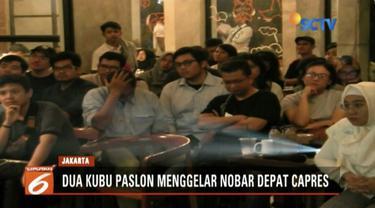 Dua kubu pendukung paslon gelar nobar debat perdana di sebuah kedai kopi di Kemayoran Baru, Jakarta.