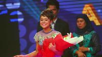 Lesti akhirnya keluar sebagai pemenang D'Academy Indonesia diusianya yang masih belia.