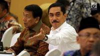 Kepala BNPT Komjen Pol Suhardi Alius dan Menkopolhukam Wiranto saat silaturahmi mantan napi dengan korban teroris di Jakarta, Rabu (28/2). Lebih dari 125 bekas napi teroris dipertemukan dengan sekitar 50 orang korban terorisme. (Liputan6.com/JohanTallo)