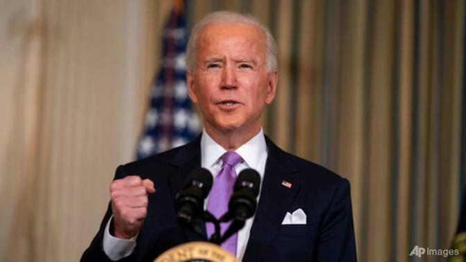 Presiden AS Joe Biden menyampaikan pidato tentang kesetaraan rasial di Ruang Makan Negara Gedung Putih pada 26 Januari 2021, di Washington. (Foto: AP / Evan Vucci)
