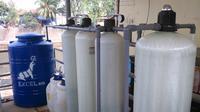 Kodam Jaya menghadiahkan alat penyulingan air minum yang sumber airnya diambil dari Sungai Ciliwung.