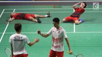 Ganda putra Indonesia, Kevin Sanjaya S/Marcus F Gideon merayakan kemenangan atas Fajar Alfian/M Rian Ardianto di Final Bulutangkis Asian Games 2018 di Istora GBK, Jakarta, Selasa (28/8). Kevin/Marcus unggul 2-1. (Liputan6.com/Helmi Fithriansyah)