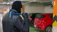 Ilustrasi Foto Pencurian dan Pencongkelan Mobil (iStockphoto)