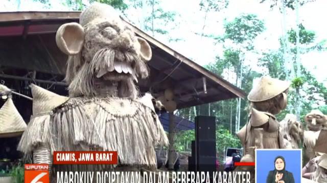 Mabokuy serupa dengan ondel-ondel yang terbuat dari alat rumah tangga berbahan anyaman bambu.