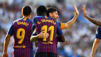 Lionel Messi dan Ousmane Dembele (AFP/GABRIEL BOUYS)