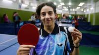 Hend Zaza. Dengan usia 11 tahun, petenis meja putri Suriah ini akan menjadi atlet termuda di Olimpiade Tokyo 2020. Pemain yang berperingkat 155 dunia ini lolos ke Olimpiade Tokyo setelah menjuarai turnamen kualifikasi zona Asia Barat di Yordania. (Foto: AFP/Louai Beshara)