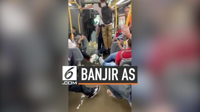 Hujan deras terjadi di Manhattan, AS dan menyebabkan banjir di sebagian kota. Air bahkan masuk ke dalam bus yang sedang melintas mengantkut penumpang.
