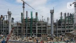 Foto areal menunjukan pembangunan jakarta International Stadium (JIS) di kawasan Sunter, Jakarta, Selasa (2/2/2021).  JIS  dibentuk dengan konsep multiuse yang berfungsi sebagai tempat menjual merchandise, maupun retail dan menelan biaya Rp 4,4 triliun rampung pada 2021. (merdeka.com/Imam Buhori)