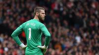 PSG kabarnya siap mendatangkan David de Gea dari Manchester United demi menjadi pengganti Gianluigi Buffon. (AFP/Paul Ellis)