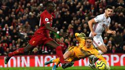 Mane sendiri memiliki kontrak dengan Liverpool hingga 2023 mendatang. Jika Madrid ingin memboyongnya maka harus menggelontorkan uang sebesar 150 juta euro untuk menebus klausul pelepasan Mane. (AFP/Paul Ellis)