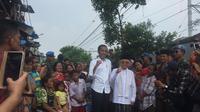 Capres Jokowi dan Cawapres Ma'ruf Amin di Kampung Deret, Johar Baru, Jakarta Pusat, Selasa (21/5/2019). (Lizsa Egeham)