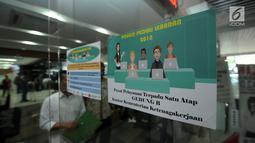 Suasana Posko Peduli Lebaran 2018 di Gedung B Kemenaker, Jakarta, Senin (28/5). Posko dibuka secara resmi oleh Menteri Ketenagakerjaan M Hanif Dhakiri. (Liputan6.com/Helmi Fithriansyah)