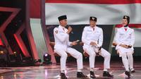 Ketiga Paskibraka Nasional 2019 yang berasal dari Tim Merah dan Tim Putih diajak bermain gim membuat sebuah lirik dari satu kata yang diberikan pembawa acara (Aditya Eka Prawira/Liputan6.com)