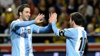 Gonzalo Higuain dan Lionel Messi (JONATHAN NACKSTRAND / AFP)
