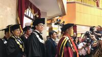 Yasonna Hamonangan Laoly dikukuhkan sebagai guru besar Sekolah Tinggi Ilmu Kepolisian (STIK) Lemdiklat Polri. (Liputan6.com/Delvira Hutabarat)
