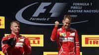Kimi Raikkonen mengaku bisa saja menjuarai F1 GP Hungaria jika tidak disuruh mengikuti Sebastian Vettel masuk pit stop. (AP/AP Photo/Darko Bandic)