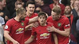 Daniel James (tengah) menjadi pemain pertama yang terkena dampak kepulangan sang bintang, Cristiano Ronaldo. Lini serang Setan Merah yang semakin padat, membuatnya dikabarkan akan dipinjamkan ke Leeds United untuk menambah jam bermainnya. (Foto: AFP/Oli Scarff)