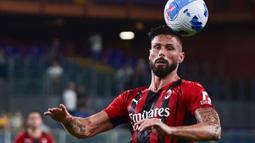 Rekrutan anyar AC Milan, Olivier Giroud juga berhasil tampil impresif pada laga debutnya di Rossoneri. Pelatih Stefano Pioli langsung mempercayakan Giroud sebagai starter di laga tersebut. (Foto: AFP/Miguel Medina)