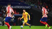 Aksi bintang Barcelona Lionel Messi saat melawan Atletico Madrid (AFP)