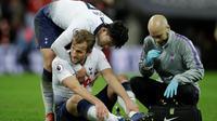 Penyerang Tottenham Hotspur, Harry Kane, harus absen selama dua bulan akibat mengalami cedera ligamen di pergelangan kaki kirinya. (AP Photo/Matt Dunham)