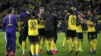 Striker Borussia Dortmund, Erling Braut Haaland, merayakan gol yang dicetaknya ke gawang Paris Saint-Germain pada leg pertama 16 besar Liga Champions di Signal Iduna Park, Dortmund, Rabu (19/2) dini hari WIB. Dortmund menang 2-1 atas PSG. (AFP/Sascha Schuermann)