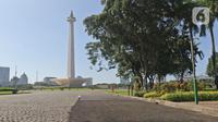 Contoh aspal lintasan Formula E terlihat di kawasan Monas, Jakarta, Minggu (23/2/2020). Aspal untuk sirkuit Formula E di uji coba di Monas, lokasi pengaspalan itu berada di Monas bagian timur. Pengaspalan dilakukan dengan dua metode, sandsheet dan geotextile. (Liputan6.com/Herman Zakharia)