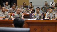 Kapolri Jenderal Polisi Idham Azis (kedua kanan) saat rapat kerja perdana dengan Komisi III DPR di Kompleks Parlemen, Jakarta, Rabu (20/11/2019). Rapat membahas anggaran, pengawasan, dan isu-isu terkini di Indonesia termasuk bom bunuh diri di Polrestabes Medan. (Liputan6.com/JohanTallo)