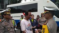 Layanan SIM dan STNK keliling di car free day (Liputan6.com/ Putu Merta Surya Putra)