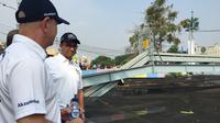 Gubernur DKI Jakarta Anies Baswedan di Kali Sentiong, Sabtu (21/7/2018). (Liputan6.com/Devira Prastiwi)