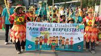 Wali Kota Surabaya Tri Rismaharini hadiri peringatan Hari Disabilitas. (Foto: Liputan6.com/Dian Kurniawan)