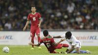Kapten Indonesia, Evan Dimas, saat pertandingan melawan Malaysia pada laga semifinal Sea Games 2017 di Stadion Shah Alam, Selangor, Sabtu (26/8/2017). Malaysia menang 1-0 atas Indonesia. (Bola.com/Vitalis Yogi Trisna)