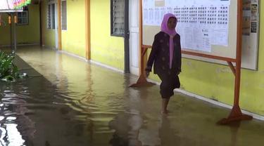 Cerita Guru SMP 7 kota Gorontalo Tetap Jalani UNBK Saat Banjir