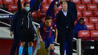 Pedri ketika lakukan debut bersama Barcelona di Liga Champions pada laga kontra Ferencvaros, Rabu dini hari WIB. (LLUIS GENE / AFP)