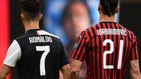 Striker AC Milan, Zlatan Ibrahimovic (kanan), dan penyerang Juventus, Cristiano Ronaldo. (AFP/Miguel Medina)