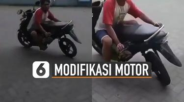 Modifikasi motor memang sering dilakukan oleh para pecinta motor. Namun ada yang unik modifikasi motor pria satu ini.