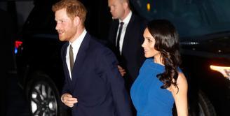 Meghan Markle dikabarkan hamil usai pergi dengan Pangeran Harry menggunakan dress yang longgar. (GETTY IMAGES-CHRIS JACKSON-Cosmopolitan)