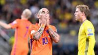 Reaksi gelandang tim nasional Belanda, Wesley Sneijder, saat menghadapi Swedia, pada laga Kualifikasi Piala Dunia 2018, di Solna, Selasa atau Rabu (7/9/2016). (AFP/Jonathan Nackstrand).