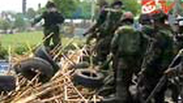 Penyerangan yang dilakukan tentara Thailand ke perkemahan Kaus Merah di pusat Bangkok menyebabkan dua korban tewas.