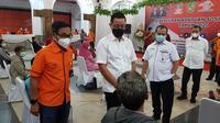 Mensos Juliari turun langsung menyalurkannya di Kantor Pos Medan, Jalan Pos, Kesawan, Medan Barat
