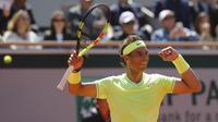 Ekspresi Rafael Nadal usai mengalahkan Roger Federer di semifinal Prancis Terbuka 2019. (AP Photo/Michel Euler)