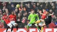 Manchester United harus puas bermain 0-0 kontra Wolverhampton Wanderers pada laga pekan ke-25 Premier League di Old Trafford, Sabtu (1/2/2020). (AFP/Lindsey Parnaby)